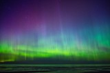 Fototapeta Beautiful Aurora Borealis over sea