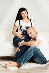 Pregnant woman with her loving husband in a happy anticipation o