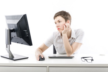Young woman bored by computer