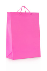 Pink shopping bag in paper on white, clipping path