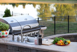 Preparing a healthy meal in an outdoor kitchen - 80580555