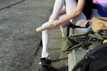 Ballerina is training in the city.