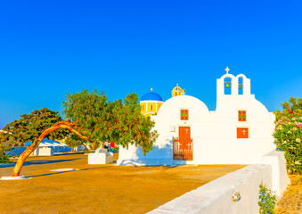 Old small white church in Oia at Santorini island in Greece