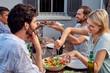 friends enjoying garden party - 80582904