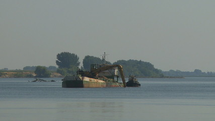 Sand extraction in river boat