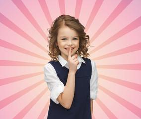 happy girl showing hush gesture