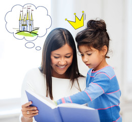 happy mother and daughter reading fairytale book