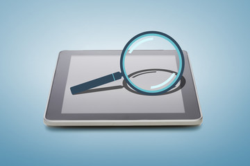 tablet pc with magnifying glass icon over screen