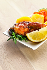 fried fish with lemon and  rosemary