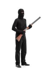 Dangerous criminal holding a shotgun rifle