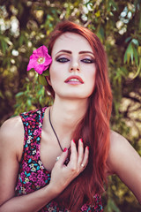 Beautiful girl with flower in her hair