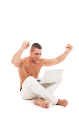 Happy caucasian man sitting on the floor with notebook over whit