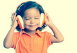 Instagram toned image of a small girl listening to music