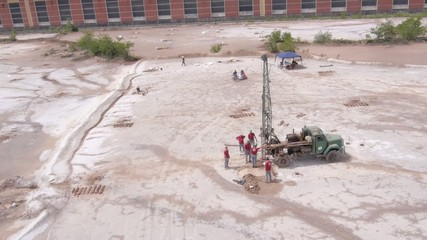 aerial view on workers taking samples from industrial waste