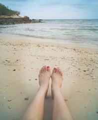 feet meet ocean.
