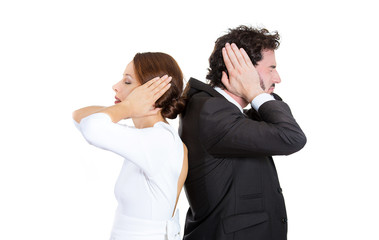 man woman couple standing with backs together covering ears