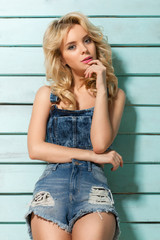 beautiful girl in denim shorts, country style