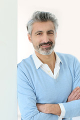 Portrait of handsome mature man with grey hair