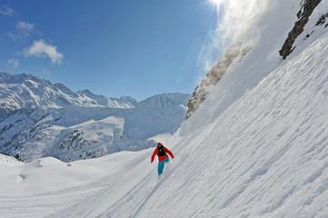 Snowboarder off-piste in powder terrain