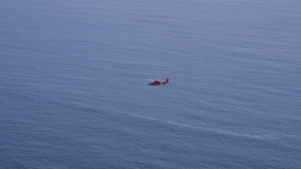 Aerial view of helicopter flying over Californian coast