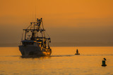 Shrimp Fishing Boat in Gulf of Mexico at sunset