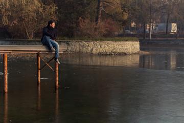 Young boy on a lake pier