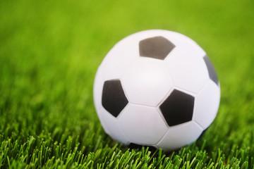 Closeup soccer ball on soccer field