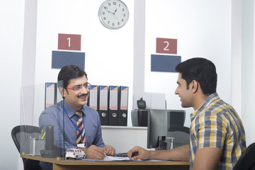 Bank manager with a customer in the bank