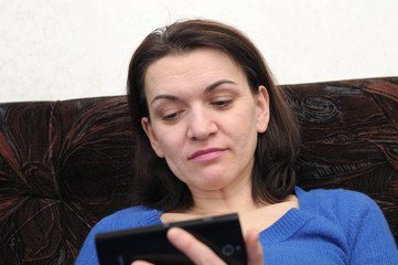 woman holding  phone, focus on face