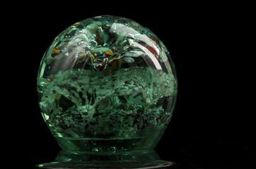 green glass bowl on a dark background