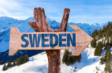 Sweden wooden sign with alps background