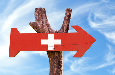 Switzerland wooden sign with sky background