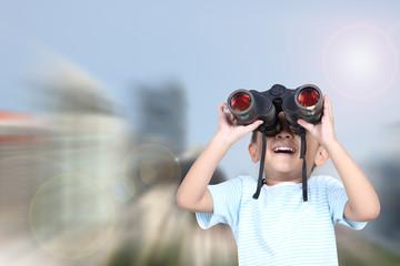 Boy using binoculars , Learning concept.