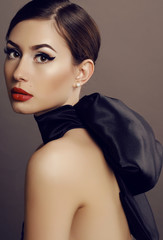 sensual woman with dark hair and bright makeup