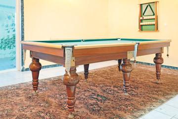 Green billiard tables