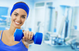 Happy woman doing fitness exercises, at gym