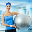 Young beautiful woman with fitness ball
