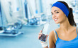 Woman drinking water at gym, with copyspace
