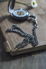 old pocket watch on old book
