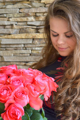 Beautiful girl with a bouquet of roses