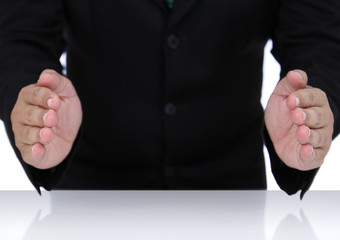 Businessman hands in protection shape
