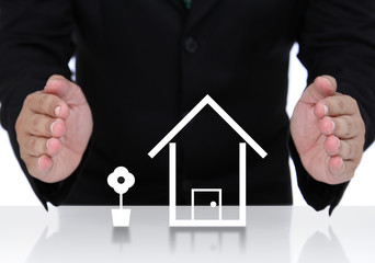 House insurance with businessman hand