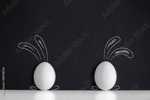 Eggs witn painted rabbirs on the black background - 80598356