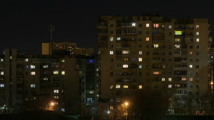 Night city. The light in the Windows of tall buildings