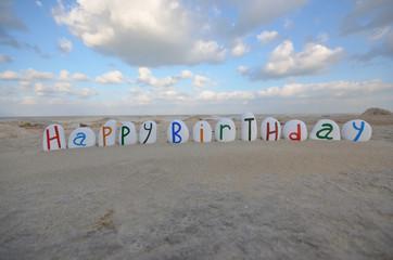 Happy Birthday on multicolored stones
