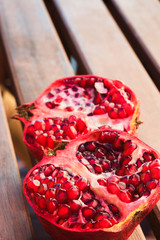 Red juicy pomegranate  fruit on wooden table
