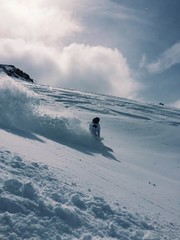 female snowboarding in back country colorado