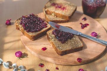 Fresh baked homemade healthy bread blackcurrant jam breakfast