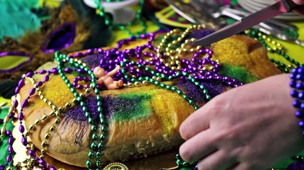 Table decorated for Mardi Gras party.