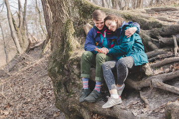 hipster couple girl and guy having great fun time walking woods